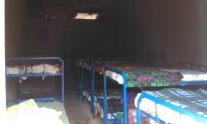 Provisorischer Schlafsaal in der Autogarage